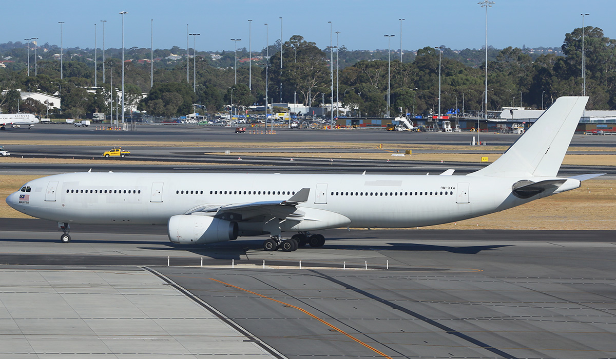 9M-XXA Airbus A330-343X (MSN 952) of AirAsia X, in all white livery, at Perth Airport - Mon 14 March 2016. This aircraft was leased to Flynas (Saudi Arabia) from 25 Aug 2014 to 1 Nov 2015, and the painted-over Flynas titles can be seen on the forward fuselage. It is now back in service with AirAsia X. Seen here taxying out to runway 03 as flight D7 237 to Kuala Lumpur at 8:35am. Photo © Ben Cambridge