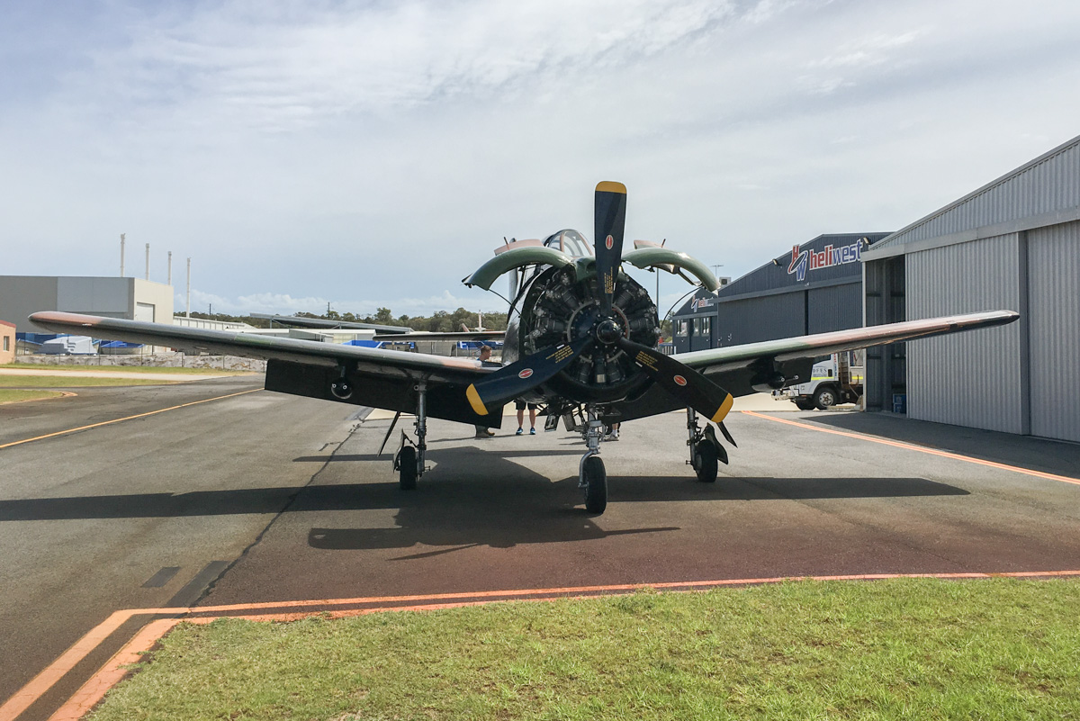 """VH-PFM / 51-3555 /TO North American T-28D Trojan (MSN 174-126) owned by Christopher Godfrey, Riddells Creek, VIC, at Jandakot Airport - Fri 25 March 2016. This aircraft has recently started flying again after maintenance. The new owner, Chris Godfrey, is receiving transition training from Steve Robinson, who owns another Trojan, VH-KAN. Chris will later fly the aircraft to its new base in Victoria, where he hopes to fly it at air shows. VH-PFM was built in 1951 as a T-28A-NI and allocated serial 51-3588 with the US Air Force. It was later converted to a T-28D and served with the US Air Force in the Vietnam War. It was sold to the Royal Lao Air Force in 1975 and allocated serial 3405. Around 1977, it was stored at Xieng Khouang airfield, until sold to Keith Death in Australia in 1988. The Trojan was dismantled, trucked to Savannakhet in western Laos and then Bangkok, before being shipped to Sydney. Initially reserved the registration VH-WPA in 1992, but this was not taken up in 1992, so it was registered to F. W. Pike, Bankstown, NSW, as VH-PFM on 30 September 1993. Registered to Anthony Mitchell on 30 July 2008 and based at Jandakot. Chris Godfrey acquired the aircraft in November 2014, but it has been stored at Jandakot until now. The aircraft has nose art with name """"Airborne Angel"""", and Vietnam War camouflage. Photo © Scott Palmer"""
