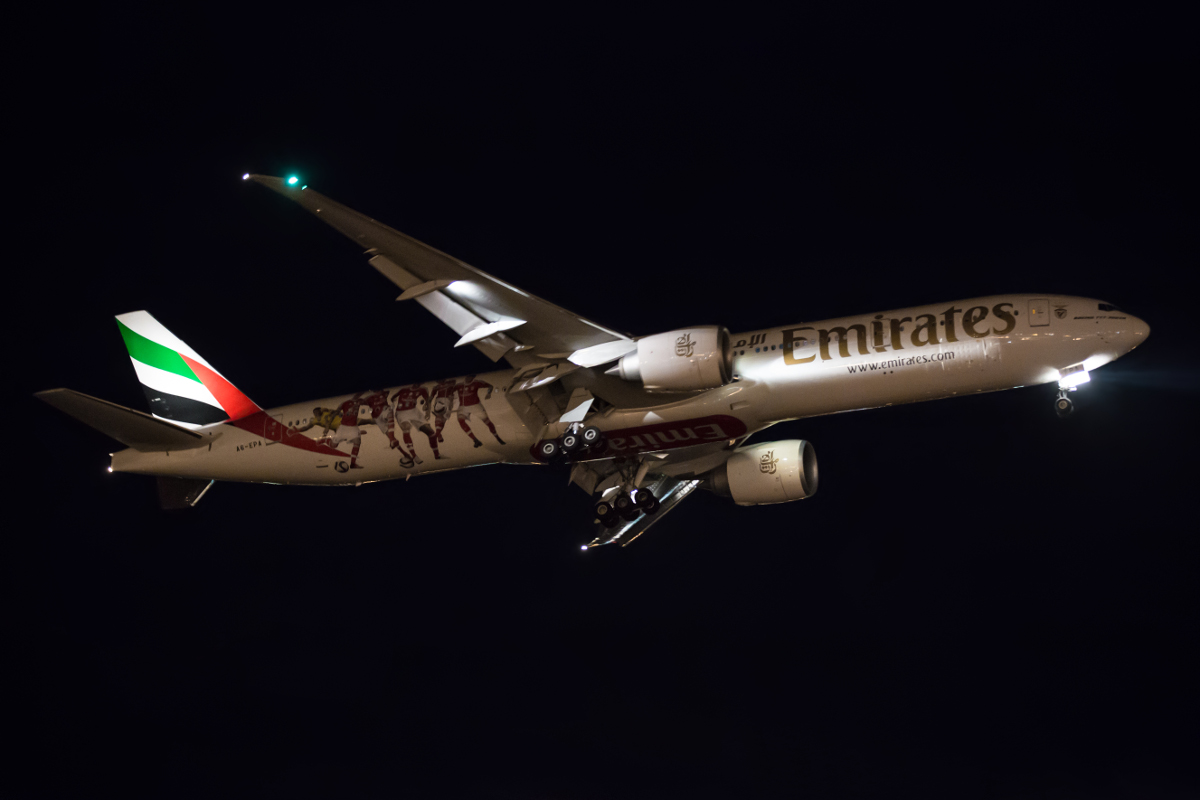 A6-EPA Boeing 777-31HER (MSN 42320/1317) of Emirates, in SL Benfica FC livery, at Perth Airport – Sun 3 April 2016. First visit to Perth wearing a special S.L Benfica Football Club scheme. Photographed on approach to runway 21 at 12:57AM as flight EK424 from Dubai. Photo © Marcus Graff