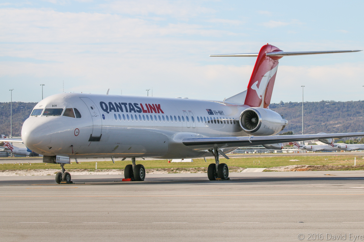 VH-NHY Fokker 100 (MSN 11467) of QantasLink (Network Aviation), at Perth Airport– Sat 23 April 2016. Parked near Terminal 3. Photo © David Eyre