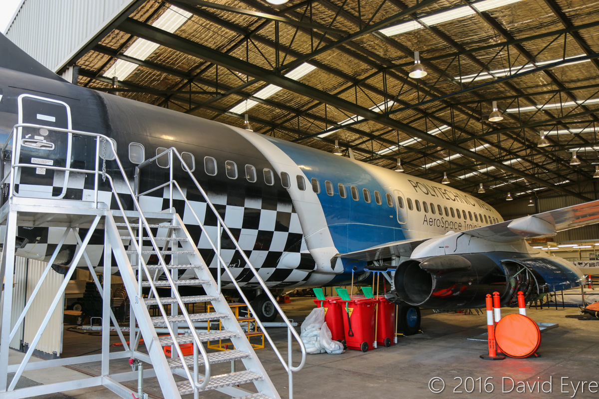 N732HV Boeing 737-229 Advanced (MSN 21137/421) owned by Polytechnic West, at Jandakot Airport - Mon 2 May 2016. Built in 1975 for Sabena Airlines (Belgium) and first flown at Renton as OO-SDM on 12 June 1975, it was accepted by Sabena on 1 July 1975. In 1993 it was sold and leased back by Sabena. In 1998 it was sold to European Aviation at Bournemouth, UK and again leased back by Sabena until August 1999, when it was returned to European Aviation. It was registered G-CEAD in October 1999 and operated by European Air Charter. In January 2006, it was delivered to Melbourne, Australia for operation by OzJet Airlines and was later re-registered VH-OBN. OzJet operated flights between Sydney and Melbourne and later from Perth to Derby-Curtin and Perth to Denpasar. VH-OBN was cancelled from the Australian Aircraft Register on 14 May 2009 and the airline ceased operations on 20 May 2009, with its fleet stored at Perth Airport. VH-OBN was re-registered N732HV in July 2009, and advertised for sale. No buyers were found for the aircraft and it was donated to Polytechnic West. On 24 April 2010, it was flown on a short flight from Perth Airport to Jandakot, becoming the largest aircraft to land at Jandakot. It is used for ground instruction in their Aerospace Training Centre facility, with its tail always protruding from the hangar. It is still kept in working order and has a full airline cabin fitout. This was a rare day when the hangar door was open. Photo © David Eyre