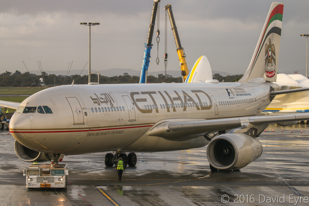 A6-EYJ Airbus A330-243 (MSN 737) of Etihad Airways, at Perth Airport - Sun 15 May 2016. A6-EYJ is pushing back from Bay 150 at 4:54pm to depart as EY487 to Abu Dhabi. Behind is UR-82060 Antonov An-225 Mriya (MSN 19530503763/01-01) of Antonov Airlines (Antonov Design Bureau), on its first visit to Australia - it arrived at 11:52AM from Kuala Lumpur as ADB3610, carrying a 117-tonne Brush generator from Prague, for Worsley Alumina Refinery. Photo © David Eyre
