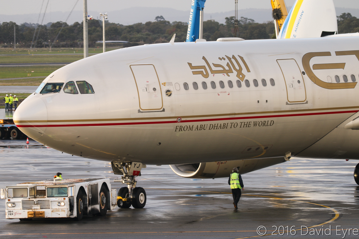 A6-EYJ Airbus A330-243 (MSN 737) of Etihad Airwaysat Perth Airport - Sun 15 May 2016. A6-EYJ is pushing back from Bay 150 at 4:54pm to depart as EY487 to Abu Dhabi. Behind is UR-82060 Antonov An-225 Mriya (MSN 19530503763/01-01) of Antonov Airlines (Antonov Design Bureau), on its first visit to Australia - it arrived at 11:52AM from Kuala Lumpur as ADB3610, carrying a 117-tonne Brush generator from Prague, for Worsley Alumina Refinery. Photo © David Eyre