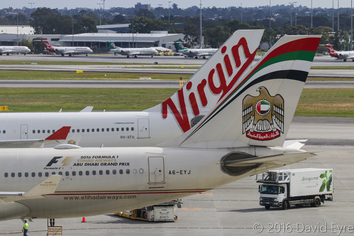 A6-EYJ Airbus A330-243 (MSN 737) of Etihad Airways, and VH-XFH Airbus A330-243 (MSN 1452) of Virgin Australia, named 'Duranbah Beach', at Perth Airport - Sun 15 May 2016. A6-EYJ is parked at Bay 150 at 1:46pm, just after arriving as EY486 from Abu Dhabi. VH-XFH is at Bay 149 and later departed as VA690 to Melbourne. Photo © David Eyre