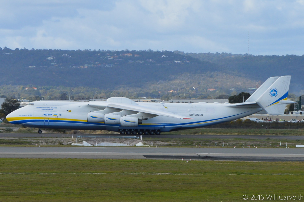 UR-82060 Antonov An-225 Mriya (MSN 19530503763/01-01) of Antonov Airlines (Antonov Design Bureau) at Perth Airport - Sun 15 May 2016. First visit by the An-225 to Australia. Slowly taxying on taxiway Charlie to the International Terminal, after landing on runway 21 at 11:52AM from Kuala Lumpur as ADB3610, carrying a 117-tonne Brush generator from Prague, for Worsley Alumina Refinery. Photo © Will Carvolth