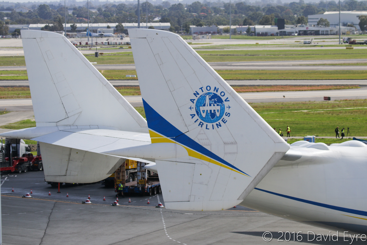 UR-82060 Antonov An-225 Mriya (MSN 19530503763/01-01) of Antonov Airlines (Antonov Design Bureau) at Perth Airport - Sun 15 May 2016. First visit by the An-225 to Australia. Landed on runway 21 at 11:52AM from Kuala Lumpur as ADB3610, carrying a 117-tonne Brush generator from Prague, for Worsley Alumina Refinery. Seen here at 12:06PM, as it slowly taxied to Bay 162, opposite the International Terminal. The bumps on the top of the fuselage are mounting points for carrying external loads, and were previously used to carry the Buran space shuttle. The twin tails were used so that they would not be affected by carriage of external loads. Photo © David Eyre