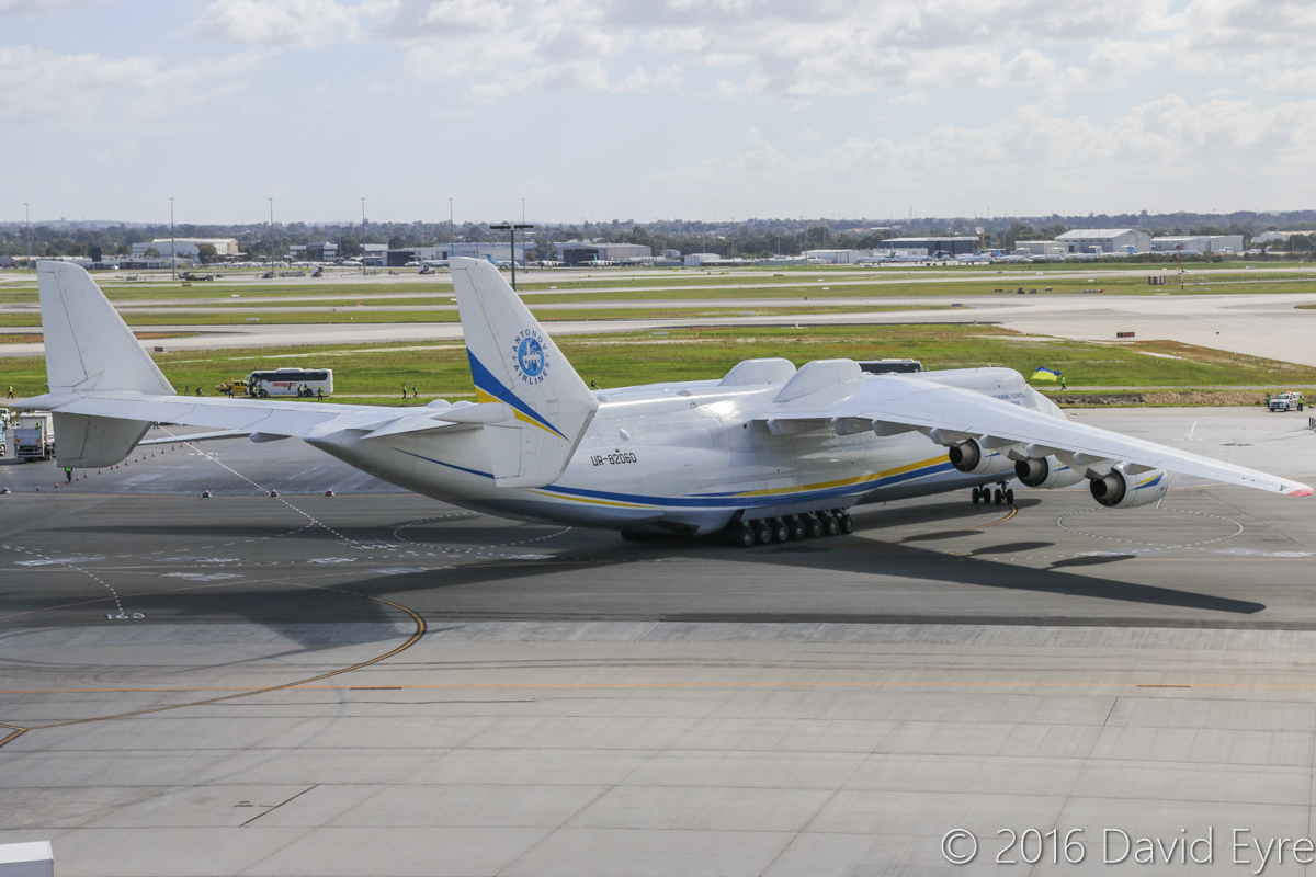 UR-82060 Antonov An-225 Mriya (MSN 19530503763/01-01) of Antonov Airlines (Antonov Design Bureau) at Perth Airport - Sun 15 May 2016. First visit by the An-225 to Australia. Landed on runway 21 at 11:52AM from Kuala Lumpur as ADB3610, carrying a 117-tonne Brush generator from Prague, for Worsley Alumina Refinery. Seen here at 12:07PM, as it slowly taxied to Bay 162, opposite the International Terminal. The bumps on the top of the fuselage are mounting points for carrying external loads, and were previously used to carry the Buran space shuttle. The twin tails were used so that they would not be affected by carriage of external loads. Photo © David Eyre