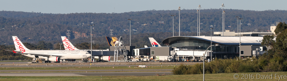 Terminal 1 Domestic at Perth Airport – Fri 27 May 2016. A pair of Virgin Australia A330-200s at Bays 148 and 149, with an Etihad A330-200 at Bay 150. Behind at Terminal 1 International are a Singapore Airlines Boeing 777-200ER and Malaysia Airlines A330-300. Photo © David Eyre