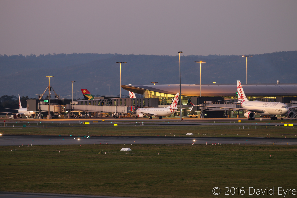Terminal 1 Domestic, at Perth Airport - Wed 1 June 2016. Virgin Australia 737-800s and A330-200s, with a South African Airways A340-300 in the distance. Photo © David Eyre