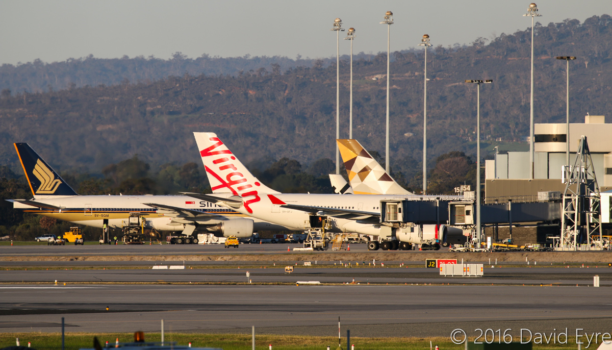 Terminal 1 at Perth Airport - Wed 1 June 2016. 9V-SQM Boeing 777-212ER of Singapore Airlines, VH-XFJ Airbus A330-243 of Virgin Australia, a Jetstar A320-232, and A6-EYI Airbus A330-243 of Etihad (operating the final Etihad A330 service to Perth before they switched to Boeing 787-9 aircraft). Photo © David Eyre