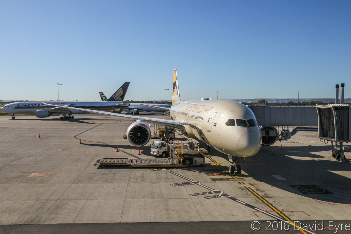 A6-BLG Boeing 787-9 Dreamliner (MSN 39652/432) of Etihad, at Perth Airport - Thu 2 June 2016. A6-BLG's first visit to Perth, and the beginning of regular Boeing 787-9 Dreamliner services to Perth by Etihad, replacing Airbus A330-200s. Flight EY486 from Abu Dhabi is parked at Bay 150 at 2:14pm. Behind is 9V-SRP Boeing 777-212ER of Singapore Airlines taxying out as SQ226 to Singapore. Photo © David Eyre