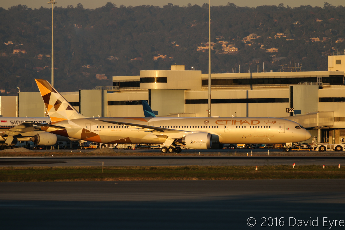 A6-BLG Boeing 787-9 Dreamliner (MSN 39652/432) of Etihad, at Perth Airport - Thu 2 June 2016. A6-BLG's first visit to Perth, and the beginning of regular Boeing 787-9 Dreamliner services to Perth by Etihad, replacing Airbus A330-200s. Flight EY487 to Abu Dhabi is seen during pushback and engine start, in front of Terminal 1 at 5:02pm. Behind is 9V-SQN Boeing 777-212ER of Singapore Airlines and PK-GNU Boeing 737-8U3 of Garuda Indonesia. Photo © David Eyre