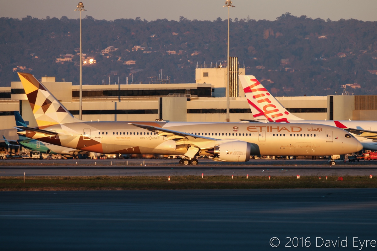 A6-BLG Boeing 787-9 Dreamliner (MSN 39652/432) of Etihad, at Perth Airport - Thu 2 June 2016. A6-BLG's first visit to Perth, and the beginning of regular Boeing 787-9 Dreamliner services to Perth by Etihad, replacing Airbus A330-200s. Flight EY487 to Abu Dhabi is seen taxying out, in front of Terminal 1 at 5:07pm. Behind is PK-GNU Boeing 737-8U3 of Garuda Indonesia and VH-XFC Airbus A330-243 of Virgin Australia. Photo © David Eyre