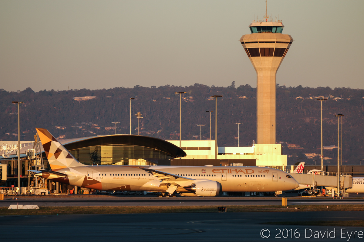 A6-BLG Boeing 787-9 Dreamliner (MSN 39652/432) of Etihad, at Perth Airport - Thu 2 June 2016. A6-BLG's first visit to Perth, and the beginning of regular Boeing 787-9 Dreamliner services to Perth by Etihad, replacing Airbus A330-200s. Flight EY487 to Abu Dhabi is seen taxying out at 5:08pm, in front of Terminal 1 Domestic and the control tower. Photo © David Eyre