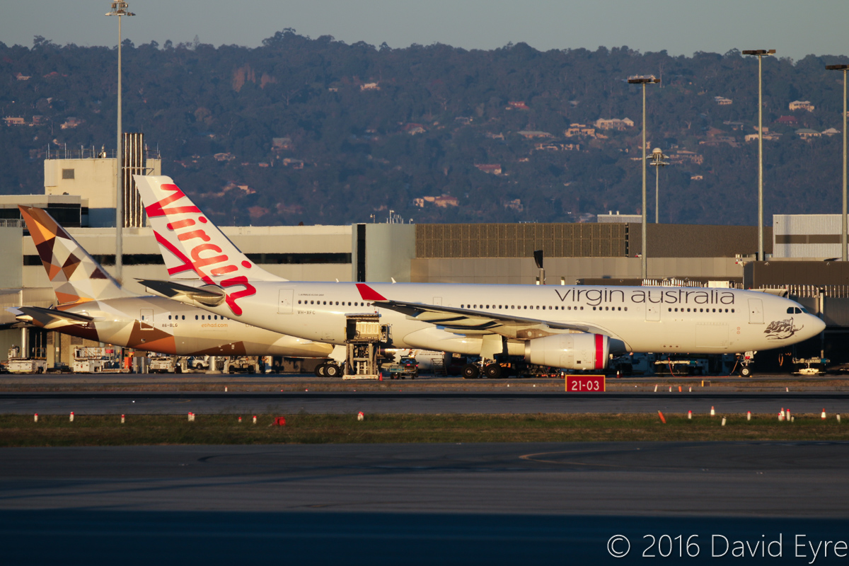 VH-XFC Airbus A330-243 (MSN 1293) of Virgin Australia, named 'Mooloolabah Beach', at Perth Airport – Thu 2 June 2016. Parked at Bay 149 at Terminal 1 Domestic at 5:01pm - it departed at 5:45pm as VA694 to Melbourne. Behind is A6-BLG Boeing 787-9 Dreamliner of Etihad at Bay 150, awaiting departure to Abu Dhabi as EY487. Photo © David Eyre