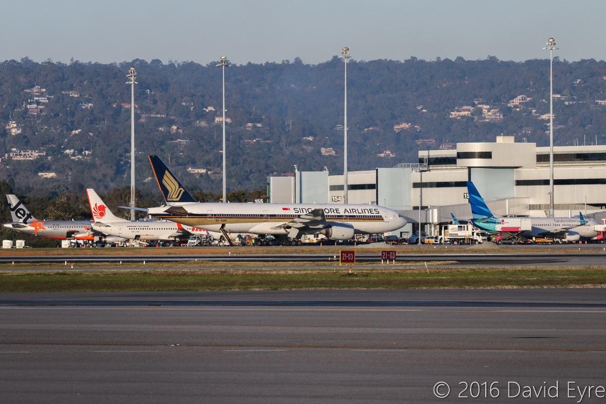 Terminal 1 at Perth Airport – Thu 2 June 2016. Photo taken at 4:34pm. Left to right: VH-VGP Airbus A320-232 (MSN 4343) of Jetstar, parked at Bay 155 - arrived at 3:28pm as JQ109 from Denpasar (Bali), departed back there at 6:05pm as JQ116. 9M-LNW Boeing 737-8GP (MSN 39875/5616) of Malindo Air, parked at Bay 154 - arrived at 4:02pm as OD151 from Kuala Lumpur, departed back as OD152 at 5:28pm. 9V-SQN Boeing 777-212ER (MSN 33373/487) of Singapore Airlines, parked at Bay 153 - arrived at 2:21pm as SQ223 from Singapore, departed back as SQ214 at 5:23pm. PK-GNU Boeing 737-8U3 (MSN 41812/5613) of Garuda Indonesia, parked at Bay 152 - arrived at 4:16pm as GA724 from Jakarta, departed back as GA725 at 6:53pm. Photo © David Eyre