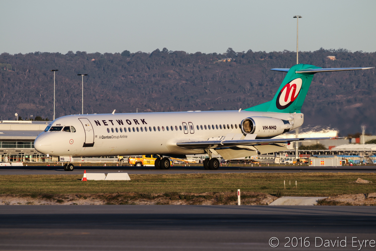 VH-NHQ Fokker 100 (MSN 11506) of Network Aviation, at Perth Airport– Thu 2 June 2016. Crossing runway 06 on taxiway J1, after landing on runway 03 at 4:54pm, arriving from Learmonth. Photo © David Eyre