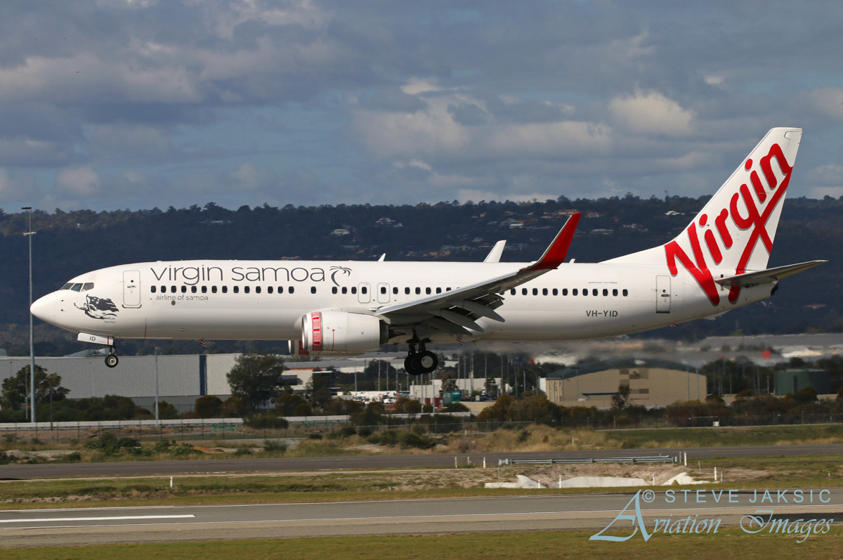 VH-YID Boeing 737-8FE (MSN 38709/3851) of Virgin Australia, with Virgin Samoa titles, named 'Tapu'itea', at Perth Airport – Sun 5 June 2016. Virgin Samoa, formerly Polynesian Blue, flies between Samoa, Australia and New Zealand. It is jointly owned by Virgin Australia Holdings and the Government of Samoa. Only one Virgin Australia aircraft wears this livery, which features traditional Samoan tattoos on the engines, designed by Tuifa'asisina Tolouena Sua. It is also used by Virgin Australia on domestic services, as seen here, landing on runway 03 at 1:24 pm as VA715 from Adelaide. Photo © Steve Jaksic