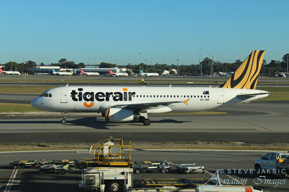 VH-VNP Airbus A320-232 (MSN 2952) of Tigerair Australia, at Perth Airport - Sat 2 July 2016. Flight TT403 from Melbourne, taxying to Terminal 2 at 9:07am. Photo © Steve Jaksic
