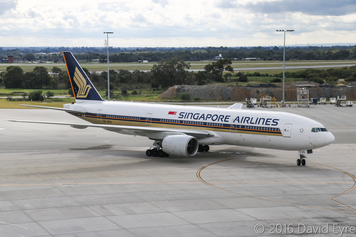 9V-SVG Boeing 777-212ER (MSN 30872/398) of Singapore Airlines at Perth Airport – Sun 3 July 2016. From 1 July 2016, Singapore Airlines SQ213/SQ226 services began to be operated by 777-200ER aircraft fitted with the Diamond J class seats (also used in their 777-300ER and A380) in a 1-2-1 configuration. SQ213 from Singapore is taxying in to Bay 154 at 12:54pm. This aircraft was previously leased to Royal Brunei from June 2010 to Dec 2013 as V8-BLB. Photo © David Eyre