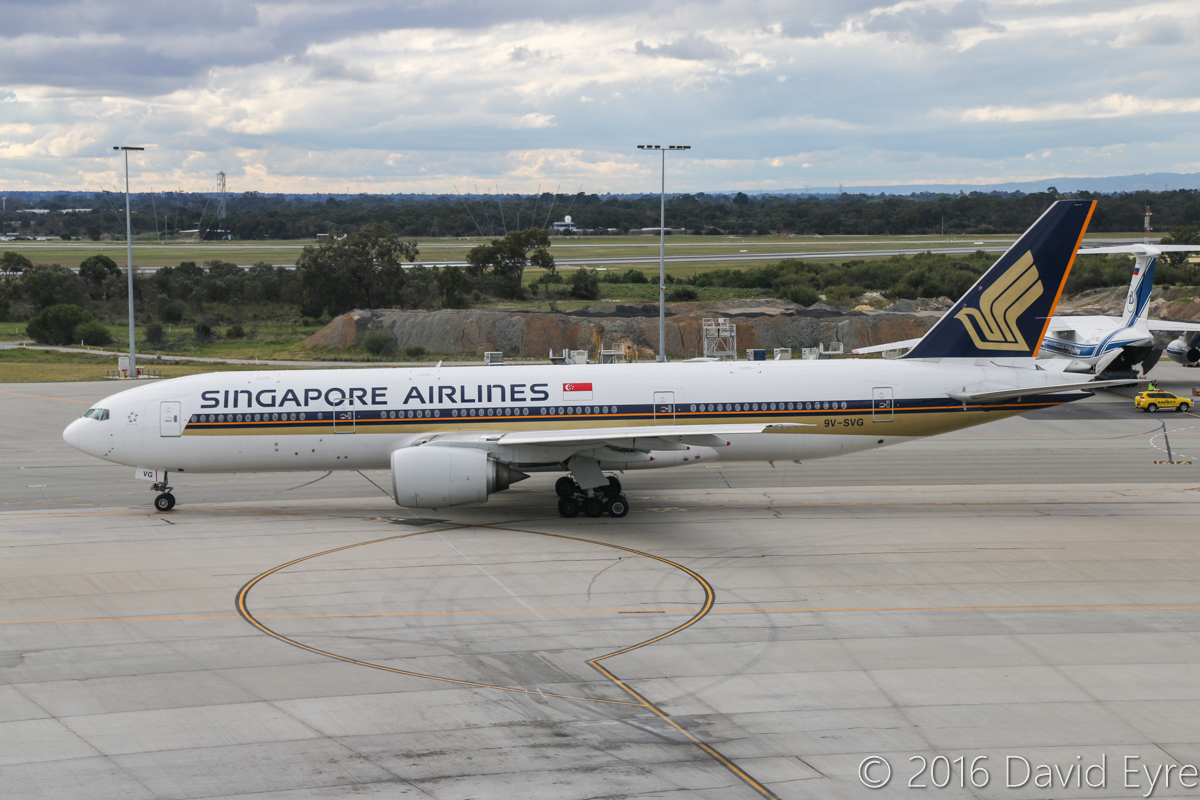 9V-SVG Boeing 777-212ER (MSN 30872/398) of Singapore Airlines at Perth Airport – Sun 3 July 2016. From 1 July 2016, Singapore Airlines SQ213/SQ226 services began to be operated by 777-200ER aircraft fitted with the Diamond J class seats (also used in their 777-300ER and A380) in a 1-2-1 configuration. SQ226 to Singapore is taxying out for departure at 2:25pm. This aircraft was previously leased to Royal Brunei from June 2010 to Dec 2013 as V8-BLB. Photo © David Eyre