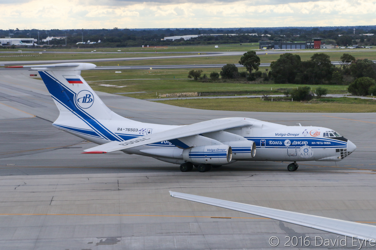 RA-76503 Ilyushin Il-76TD-90VD (MSN 2113422748 / 94-07) of Volga-Dnepr Airlines at Perth Airport – Sun 3 July 2016. Wears Antarctic Logistics Centre International logo and penguins, and 25 Years logo. Taxying in at 1:20pm as flight VI4900 from Jakarta-Halim. RA-76503 was originally rolled out of the factory in Tashkent, Uzbekistan, on 30 September 2011, and made its first flight on 15 October 2011. It first visited Perth in May and July 2013. Photo © David Eyre