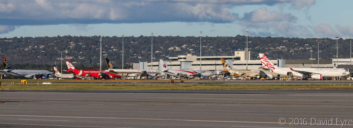 Terminal 1 at Perth Airport - Mon 18 July 2016. ZS-SXB Airbus A340-313X (MSN 582) of South African Airways; 9M-LNV Boeing 737-8GP (MSN 39867/5635) of Malindo Air at Bay 156; VH-VGO Airbus A320-232 of Jetstar at Bay 155; 9M-XXY Airbus A330-343X (MSN 1600) of AirAsia X at Bay 154; 9V-SRP Boeing 777-212ER (MSN 33369/448) of Singapore Airlines at Bay 153; 9M-MTK Airbus A330-323X (MSN 1388) of Malaysia Airlines at Bay 152 ; A6-BLE Boeing 787-9 Dreamliner (MSN 39650/305) of Etihad at Bay 151; VH-XFJ Airbus A330-243 (MSN 1561), named 'Gnaraloo Bay', of Virgin Australia, at Bay 148. Photo © David Eyre
