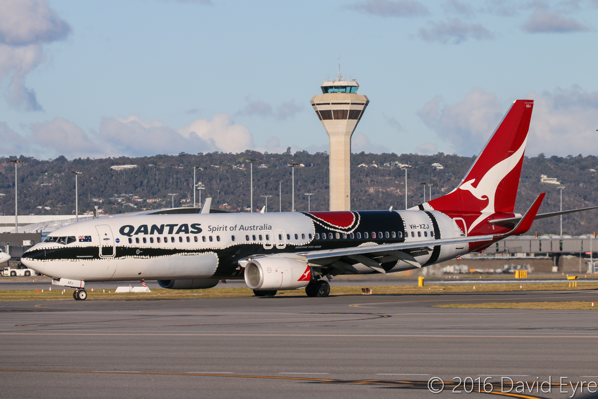 VH-XZJ Boeing 737-838 (MSN 39365/4669) of Qantas, named 'Mendoowoorrji', in Aboriginal art livery, at Perth Airport – Mon 18 July 2016. Taxying in after landing on runway 24 at 4:16pm, as QF793 from Darwin. Photo © David Eyre