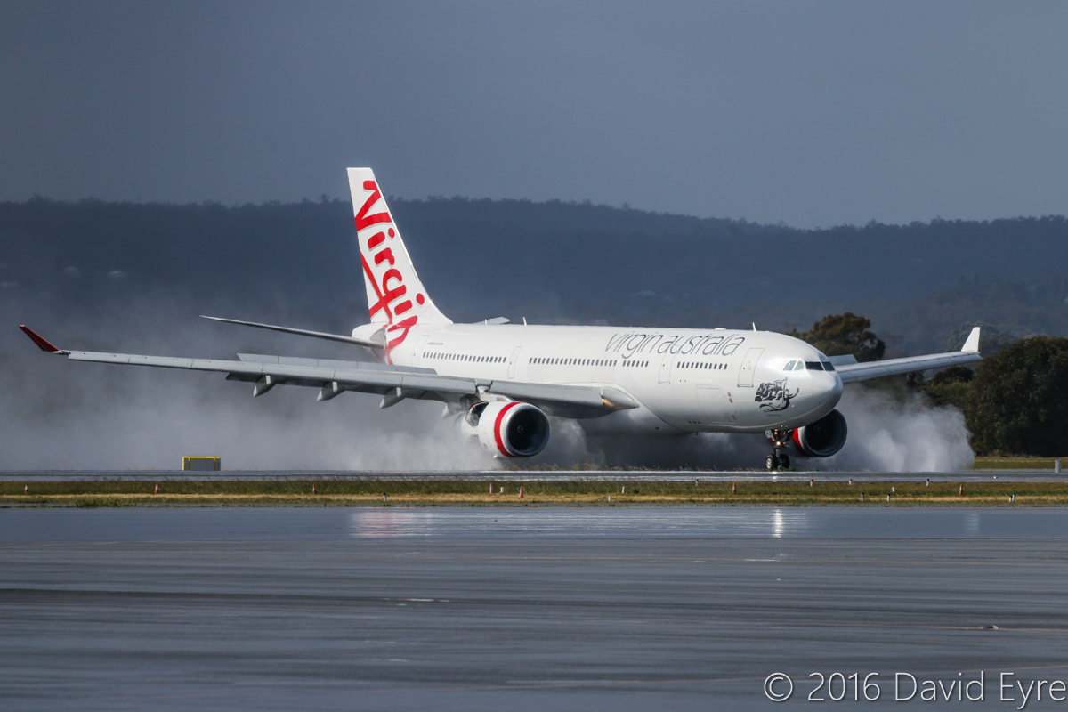 VH-XFJ Airbus A330-243 (MSN 1561) of Virgin Australia, named 'Gnaraloo Bay', at Perth Airport – Sun 31 July 2016. Flight VA553 from Sydney, landing on runway 24 at 12:08pm kicking up water spray as it uses its thrust reversers to slow down on the wet runway. Photo © David Eyre