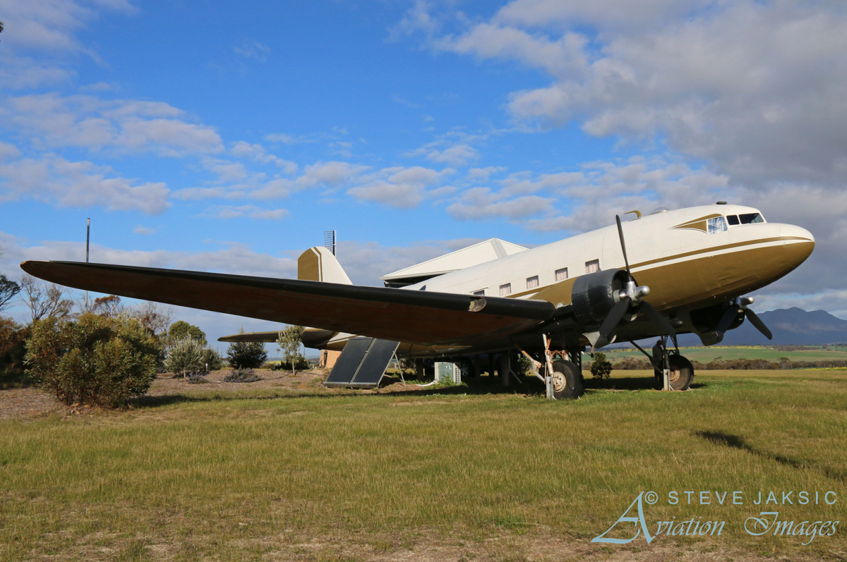 "(43-15575) Douglas C-47A-85-DL Skytrain (MSN 20071) at The Lily Dutch Windmill, south of Borden, WA - Sat 13 August 2016. Now used as holiday accommodation, sleeping two people. Built in 1944, ex 43-15575 (USAAF), DT-971 (Netherlands East Indies Air Force), VHREY, PK-REY (Garuda), ""VN-BME"", 43-15575. Photo © Steve Jaksic"
