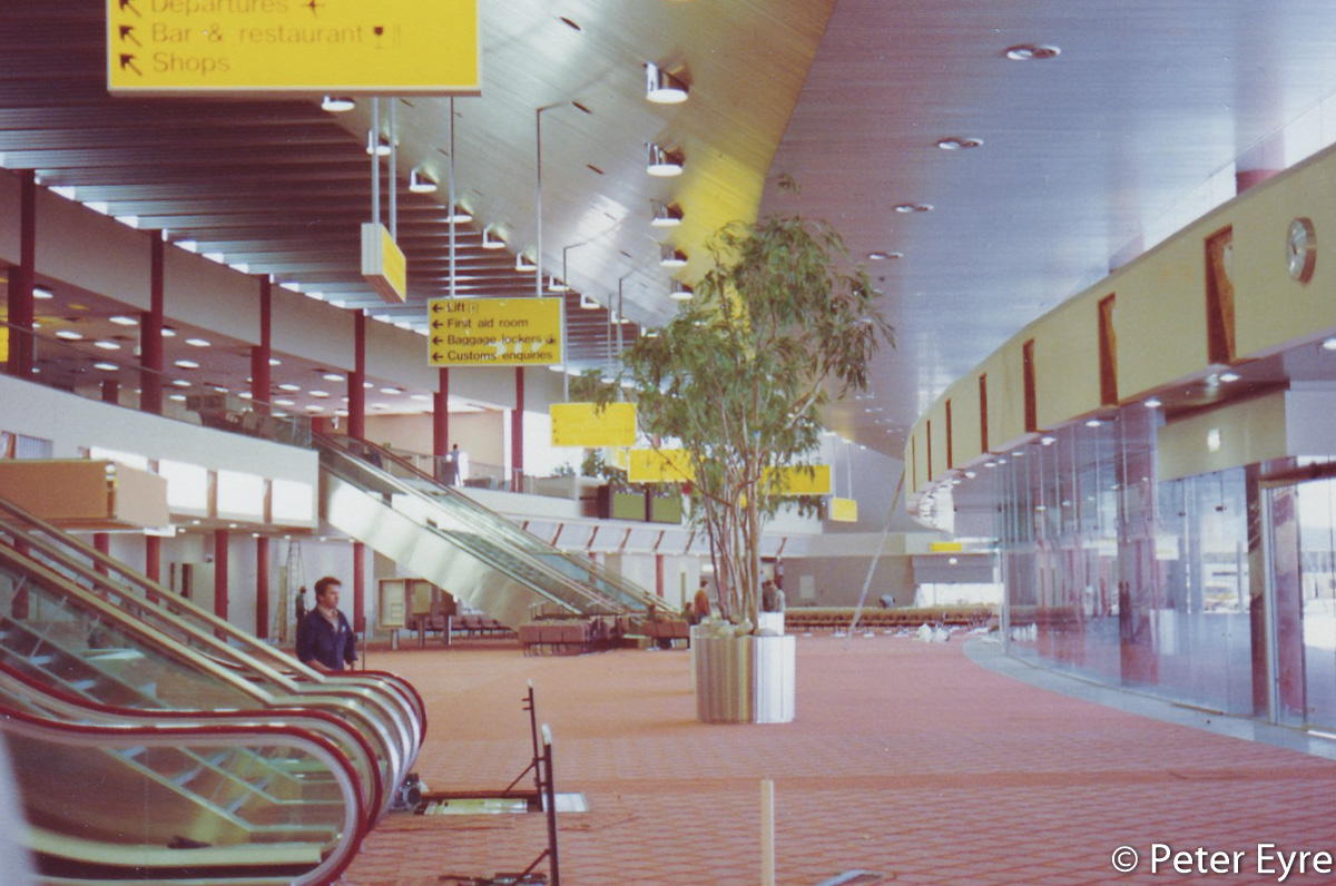 Inside the new International Terminal, later Terminal 1 International at Perth Airport - 23 October 1986. This photo was taken two days before the official opening and four days before operations commenced, facing east towards the Arrivals area. Workers were hurriedly finishing off the terminal. T1 opened on 25 October 1986 and started operations on 27 October 1986. Photo © Peter Eyre