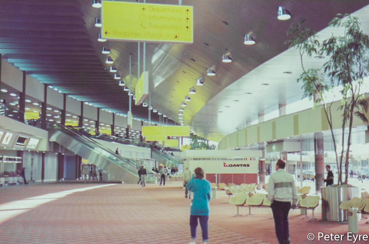 Inside the new International Terminal (later Terminal 1 International) on its first day of operations, at Perth Airport - Monday 27 October 1986. This view is facing east from the check-in counters towards the escalators to Level 1. Photo © Peter Eyre