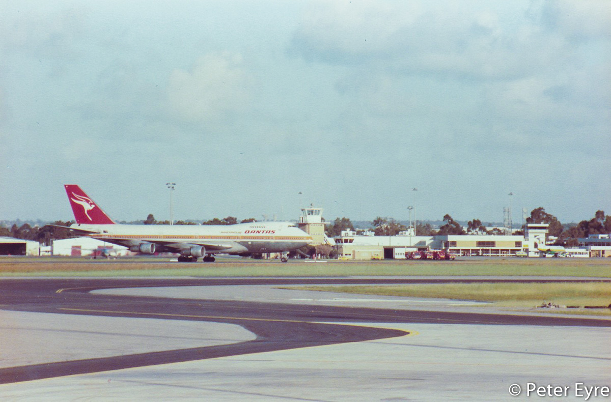 VH-EBG Boeing 747-238B (MSN 20841/233) of Qantas, named 'City of Fremantle', - first flight to arrive at the new International Terminal at Perth Airport - Mon 27 October 1986. Flight QF78 from Hong Kong, taxying in after landing at 6:20am. It parked at Gate 3 (Bay 53, later Bay 153). The 382 passengers aboard only took 20 minutes to pass through Customs and collect their baggage. This same aircraft then operated the first departure from the new Terminal, flight QF75 to Denpasar (Bali) at 9:30am. Photo © Peter Eyre
