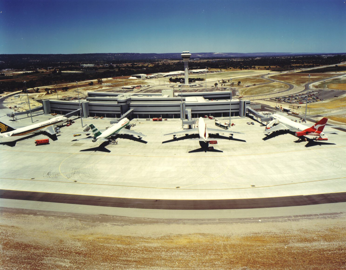 Perth Airport International Terminal (Terminal 1) in 1986. In this view are three Boeing 747-200B aircraft of Singapore Airlines on Bay 54, Cathay Pacific on Bay 53 and Qantas on Bay 52, with a Qantas 747-300 on Bay 51. Photo © Aviation Institute Journal via Perth Airport