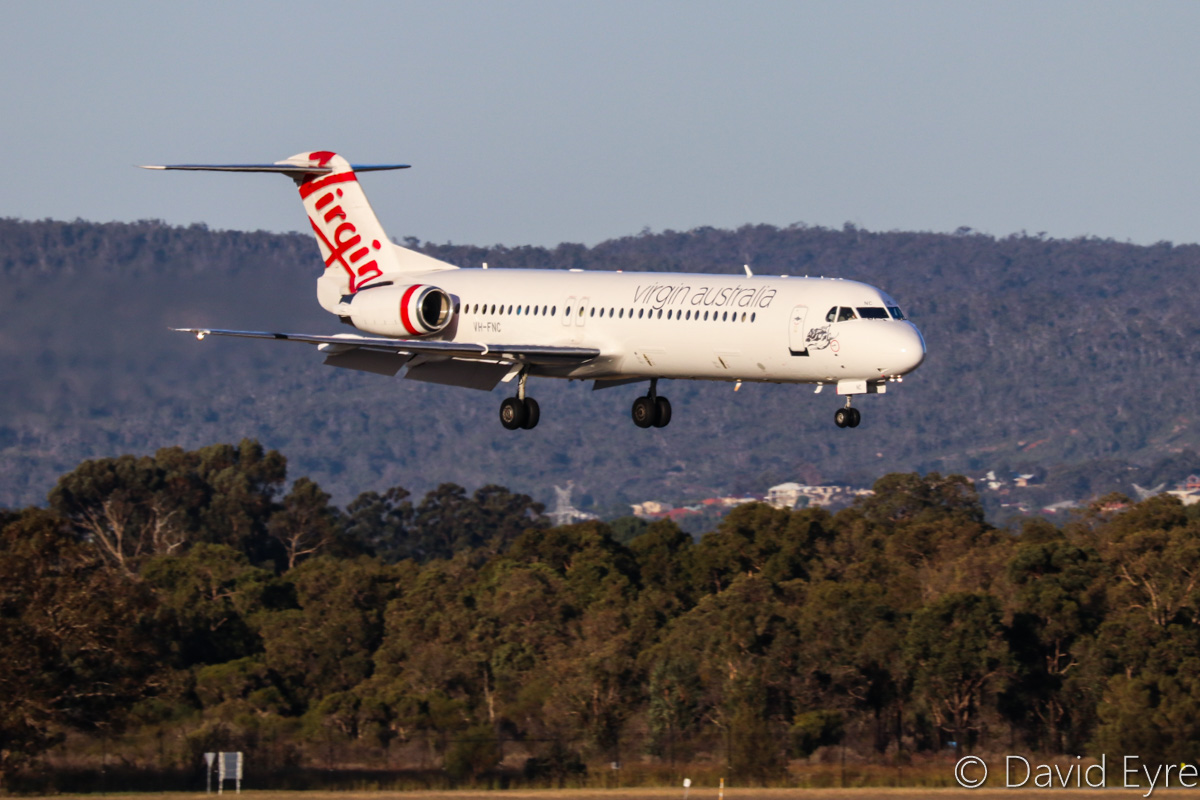VH-FNC Fokker 100 (MSN 11334) of Virgin Australia Regional Airlines, at Perth Airport - Wed 5 February 2014. Flight VA1016 from Paraburdoo, about to land on runway 21 at 5:40pm. Photo © David Eyre