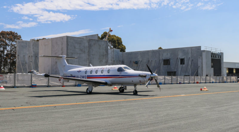 VH-ZWO Pilatus PC-12/45 (MSN 467) of Royal Flying Doctor Service (Western Operations) in front of the new RFDS hangar under construction, at Jandakot Airport - Fri 28 October 2016. $3.9 million was provided by Lotterywest to construct the new hangar, which will be used for three Pilatus PC-24 jets being delivered to RFDS Western Operations. The first PC-24 arrives in early 2018, the second soon after and the third in 2019. One of the current hangars is on the right, with three Pilatus PC-12 turboprops undergoing maintenance inside. Photo © David Eyre