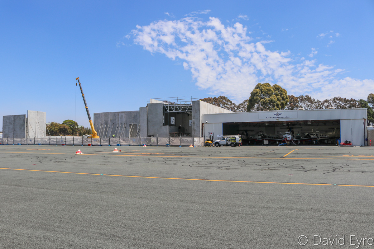 New Royal Flying Doctor Service hangar under construction, at Jandakot Airport - Fri 28 October 2016. $3.9 million was provided by Lotterywest to construct the new hangar, which will be used for three Pilatus PC-24 jets being delivered to RFDS Western Operations. The first PC-24 arrives in early 2018, the second soon after and the third in 2019. One of the current hangars is on the right, with three Pilatus PC-12 turboprops undergoing maintenance inside. Photo © David Eyre