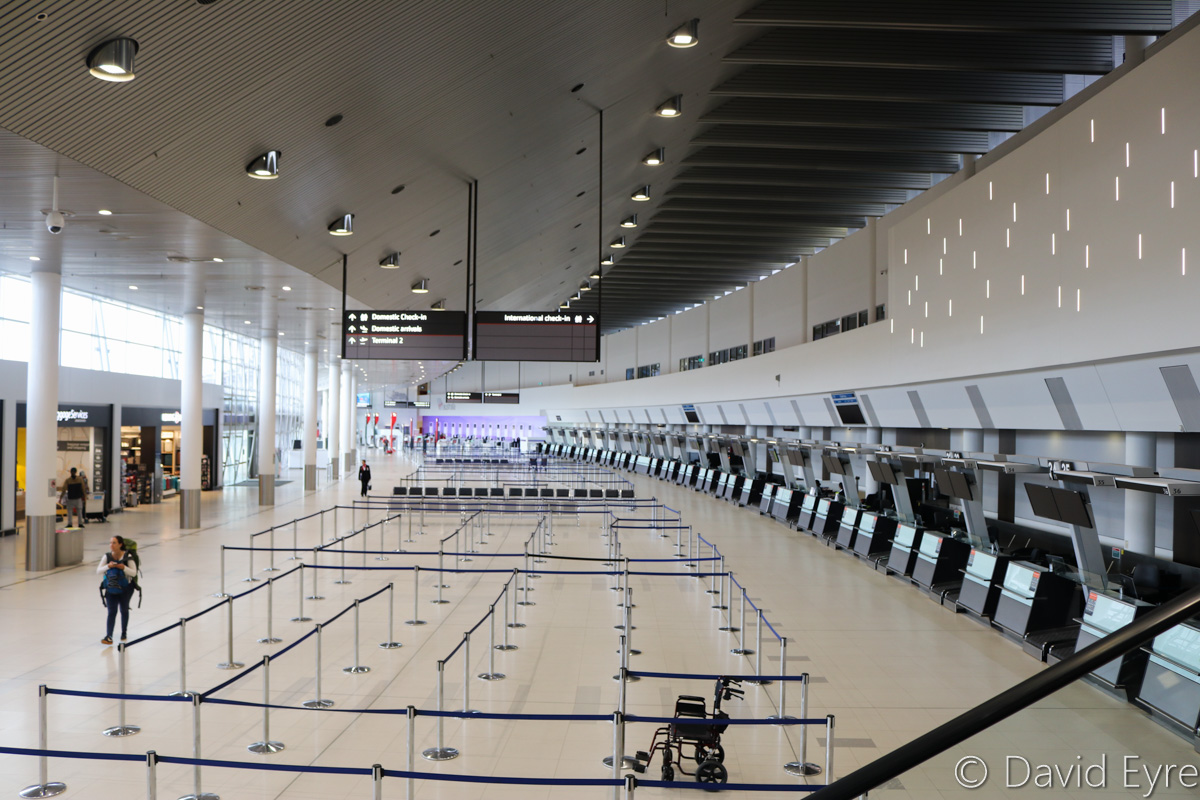 Check-in area at Terminal 1 International, Perth Airport - Sat 29 October 2016. The purple area in the distance is the Virgin Australia check-in area at Terminal 1 Domestic. Photo © David Eyre
