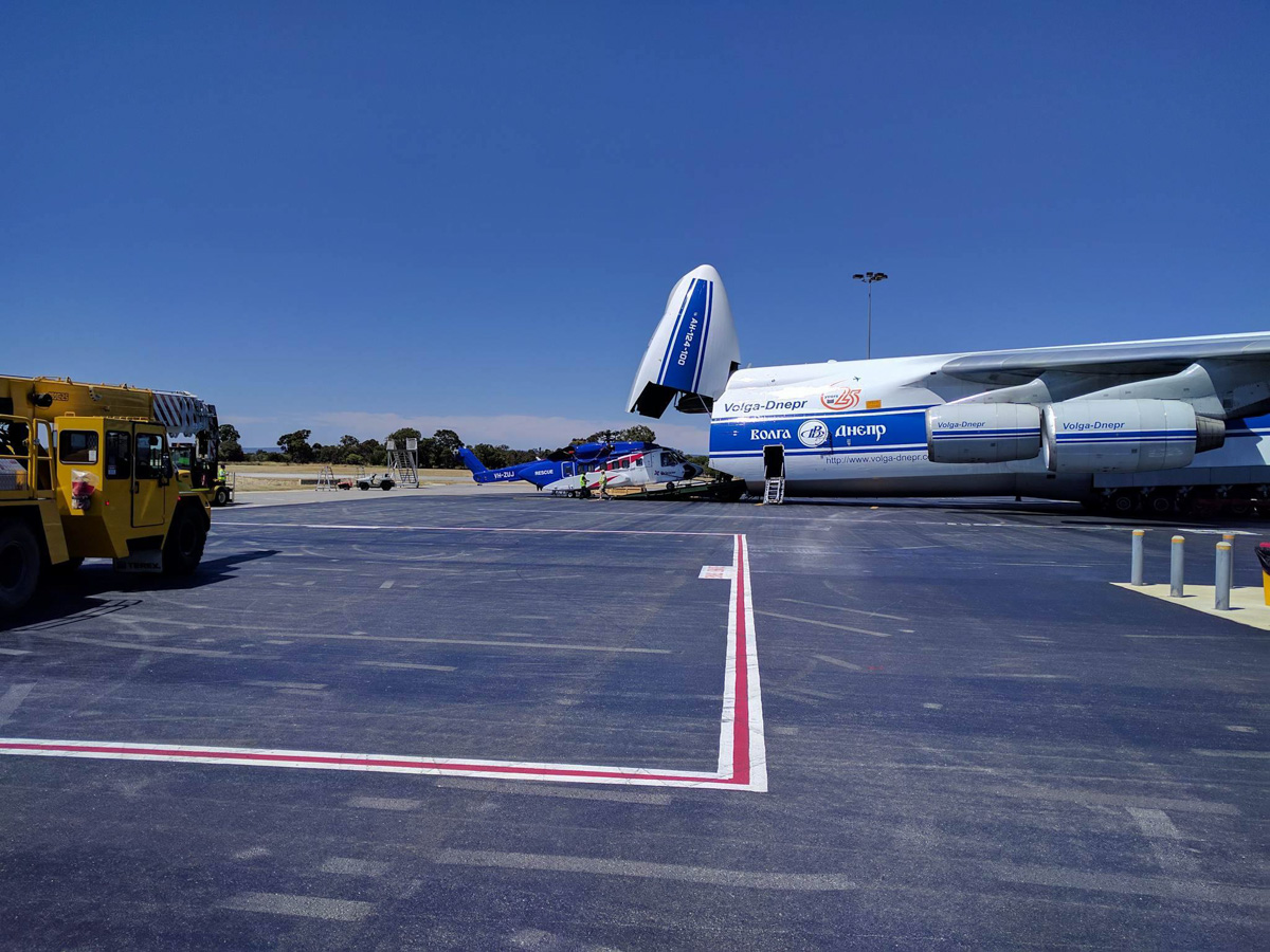 RA-82079 Antonov An-124-100 (MSN 9773052062157) of Volga-Dnepr Airlines, with VH-ZUJ Sikorsky S-92A Helibus of Bristow Helicopters Australia, at Perth Airport - Wed 23 November 2016. The An-124 picked up two Sikorsky S-92s, VH-ZUJ and N392BG, from Bristow's US base at Acadiana Regional Airport, New Iberia, Louisiana on Sunday 20 November 2016. It flew via Houston (Texas), Honolulu (Hawaii), Port Moresby (PNG) to Perth, where it landed at 11:57am today. After the helicopters were offloaded from the An-124, they were loaded onto flatbed trucks and taken by road to Broome.