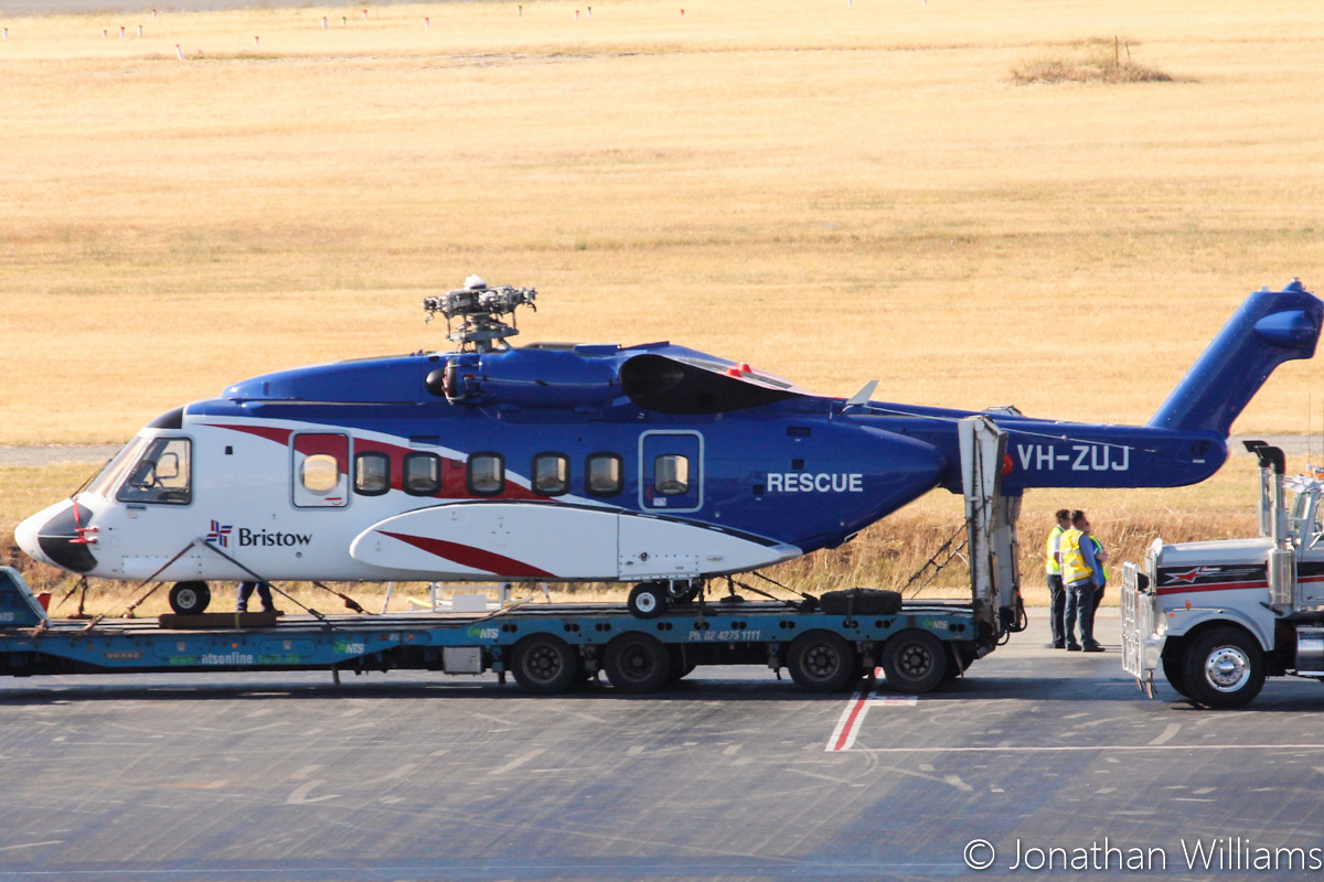 VH-ZUJ Sikorsky S-92A Helibus of Bristow Helicopters, at Perth Airport - Wed 23 November 2016. RA-82079 Antonov An-124-100 of Volga-Dnepr picked up two Sikorsky S-92s, VH-ZUJ and N392BG, from Bristow's US base at Acadiana Regional Airport, New Iberia, Louisiana on Sunday 20 November 2016. It flew via Houston (Texas), Honolulu (Hawaii), Port Moresby (PNG) to Perth, where it landed at 11:57am today. After the helicopters were offloaded from the An-124, they were loaded onto flatbed trucks and taken by road to Broome. Photo © Jonathan Williams