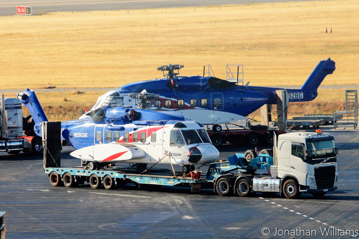 VH-ZUJ and N392BG Sikorsky S-92A Helibus of Bristow Helicopters, at Perth Airport - Wed 23 November 2016. RA-82079 Antonov An-124-100 of Volga-Dnepr picked up two Sikorsky S-92s, VH-ZUJ and N392BG, from Bristow's US base at Acadiana Regional Airport, New Iberia, Louisiana on Sunday 20 November 2016. It flew via Houston (Texas), Honolulu (Hawaii), Port Moresby (PNG) to Perth, where it landed at 11:57am today. After the helicopters were offloaded from the An-124, they were loaded onto flatbed trucks and taken by road to Broome. Photo © Jonathan Williams