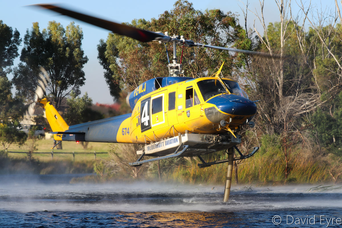 P2-MLJ / HELITACK 674 Bell 214B1 BigLifter (MSN 28066) owned by McDermott Aviation, contracted to the WA Government, at Warradale Park, Landsdale - Wed 23 November 2016. Refilling its 2,700-litre water tank. Assisting firefighters in fighting a suspiciously-lit bushfire in Lexia, at the Gnangara pine plantation, that burnt through 100 hectares. Built in 1981, ex N2179R, JA9304, N4410N, C-GTWG, F-GJKZ, N214JL. Photo © David Eyre