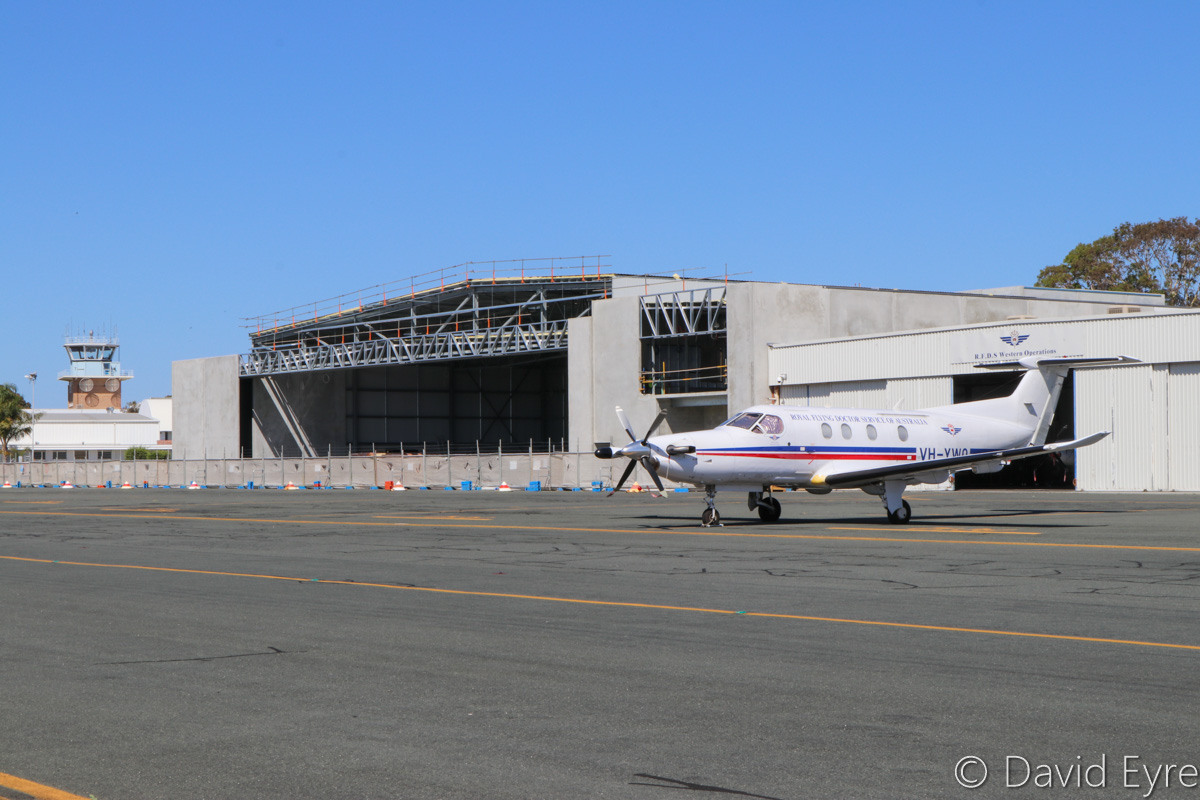 VH-YWO Pilatus PC-12/47 (MSN 725) of Royal Flying Doctor Service (Western Operations) in front of the new RFDS hangar under construction, at Jandakot Airport - Sat 10 December 2016. $3.9 million was provided by Lotterywest to construct the new hangar, which will be used for three Pilatus PC-24 jets being delivered to RFDS Western Operations. The first PC-24 arrives in early 2018, the second soon after and the third in 2019. One of the current hangars is on the right, with Pilatus PC-12 turboprops undergoing maintenance inside. Photo © David Eyre
