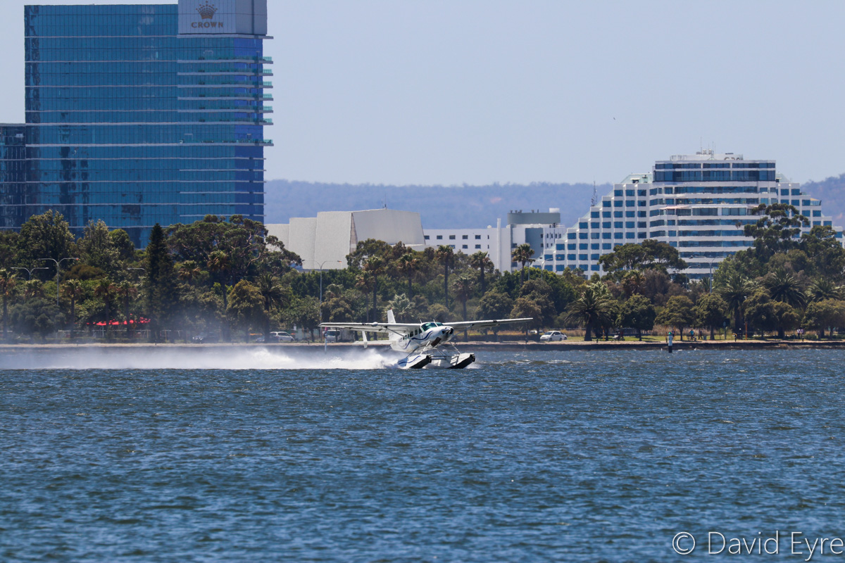 VH-MOX Cessna 208 Caravan (amphibious seaplane) (MSN 20800227) operated by Swan River Seaplanes (West Coast Air Services Pty Ltd/Avanova Pty Ltd), Swan River, South Perth - Mon 23 January 2017. Taking-off from the Swan River at 12:16pm, after the official ceremony to launch seaplane tourism services between Perth's Swan River and Margaret River Airstrip, including tours of Margaret River wineries. Crown Resort at Burswood in the background. Photo © David Eyre