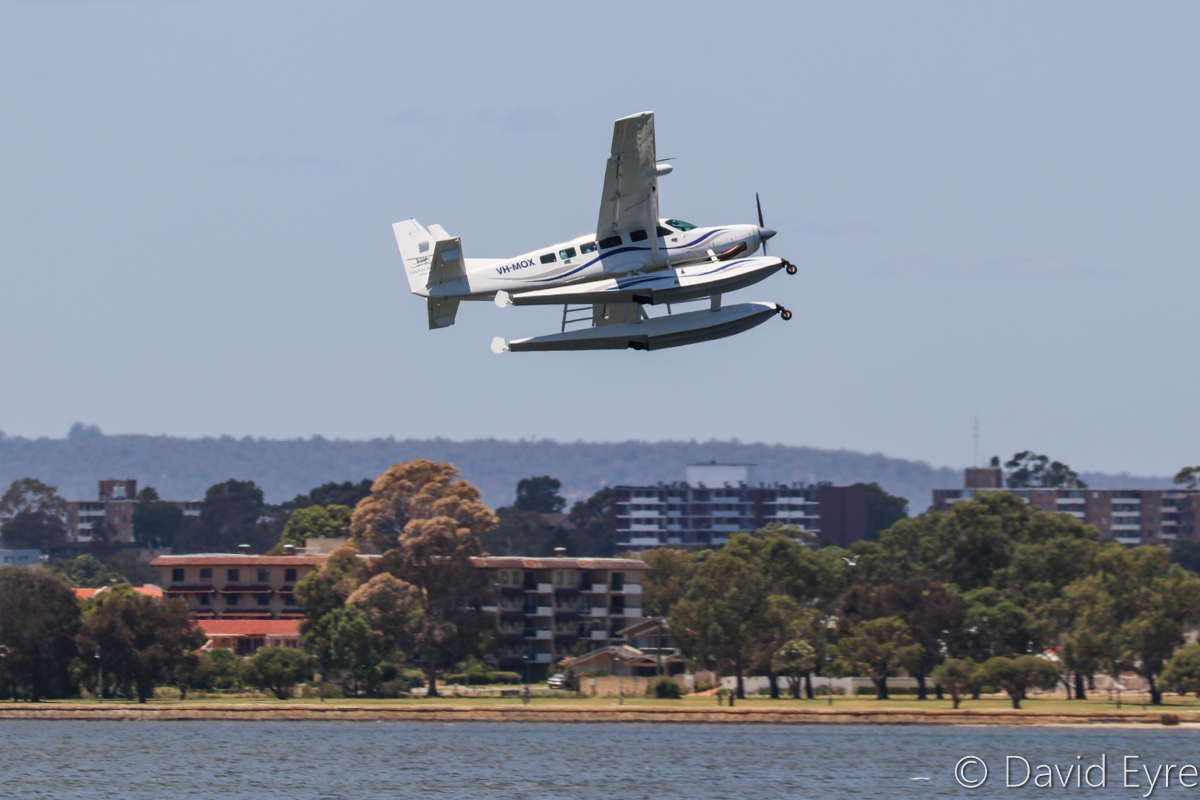VH-MOX Cessna 208 Caravan (amphibious seaplane) (MSN 20800227) operated by Swan River Seaplanes (West Coast Air Services Pty Ltd/Avanova Pty Ltd), Swan River, South Perth - Mon 23 January 2017. Just after take-off from the Swan River at 12:16pm, after the official ceremony to launch seaplane tourism services between Perth's Swan River and Margaret River Airstrip, including tours of Margaret River wineries. Photo © David Eyre