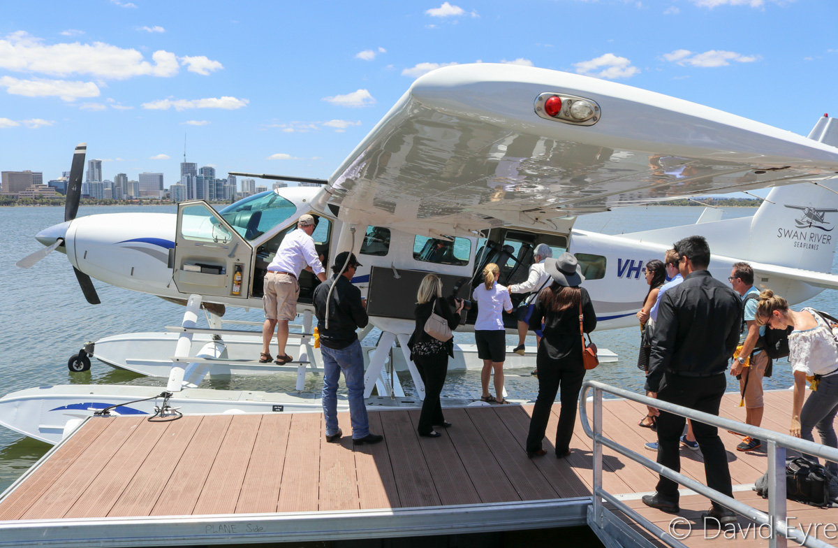 VH-MOX Cessna 208 Caravan (amphibious seaplane) (MSN 20800227) operated by Swan River Seaplanes (West Coast Air Services Pty Ltd/Avanova Pty Ltd), at Queen Street Jetty, South Perth - Mon 23 January 2017. Passengers, including South Perth Mayor Sue Doherty, board the aircraft at 12:04pm for departure to Margaret River, following the official launch ceremony. Photo © David Eyre