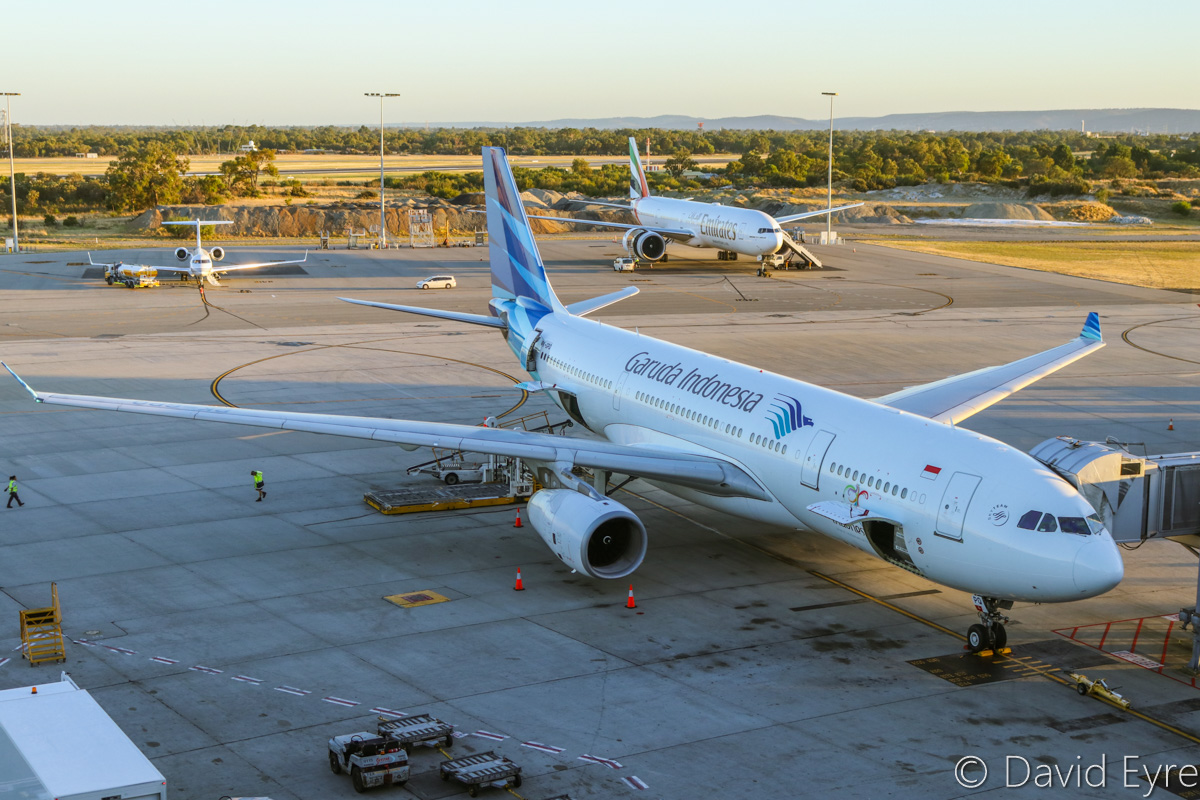 PK-GPQ Airbus A330-243 (MSN 1410) of Garuda Indonesia, at Perth Airport - Mon 6 February 2017. Parked on bay 154 at 6.02am, preparing to depart back to Denpasar (Bali) as flight GA727. Behind are VH-FMG Bombardier BD-700-1A10 Global Express (MSN 9015) of FMG Air Pty Ltd, and A6-EGH Boeing 777-31H ER (MSN 35585/969) of Emirates, which operated a late EK424 service from Dubai the previous night. Photo © David Eyre