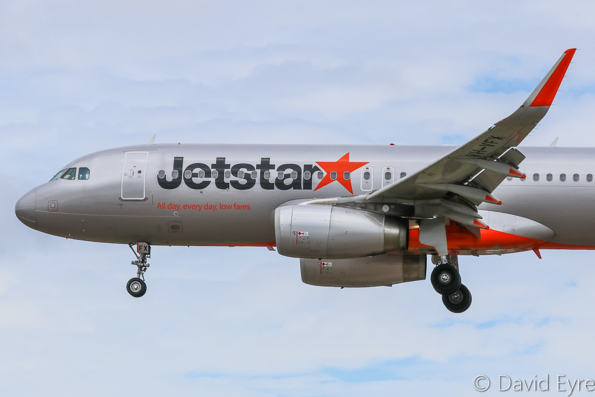 "VH-VFX Airbus A320-232 (WL) (MSN 5871) of Jetstar at Perth Airport – Sat 11 February 2017. Flight JQ117 from Denpasar (Bali), about to land on runway 06 at 12:20pm. VH-VFX formerly wore ""Kung Fu Panda 3"" movie decals. Photo © David Eyre"