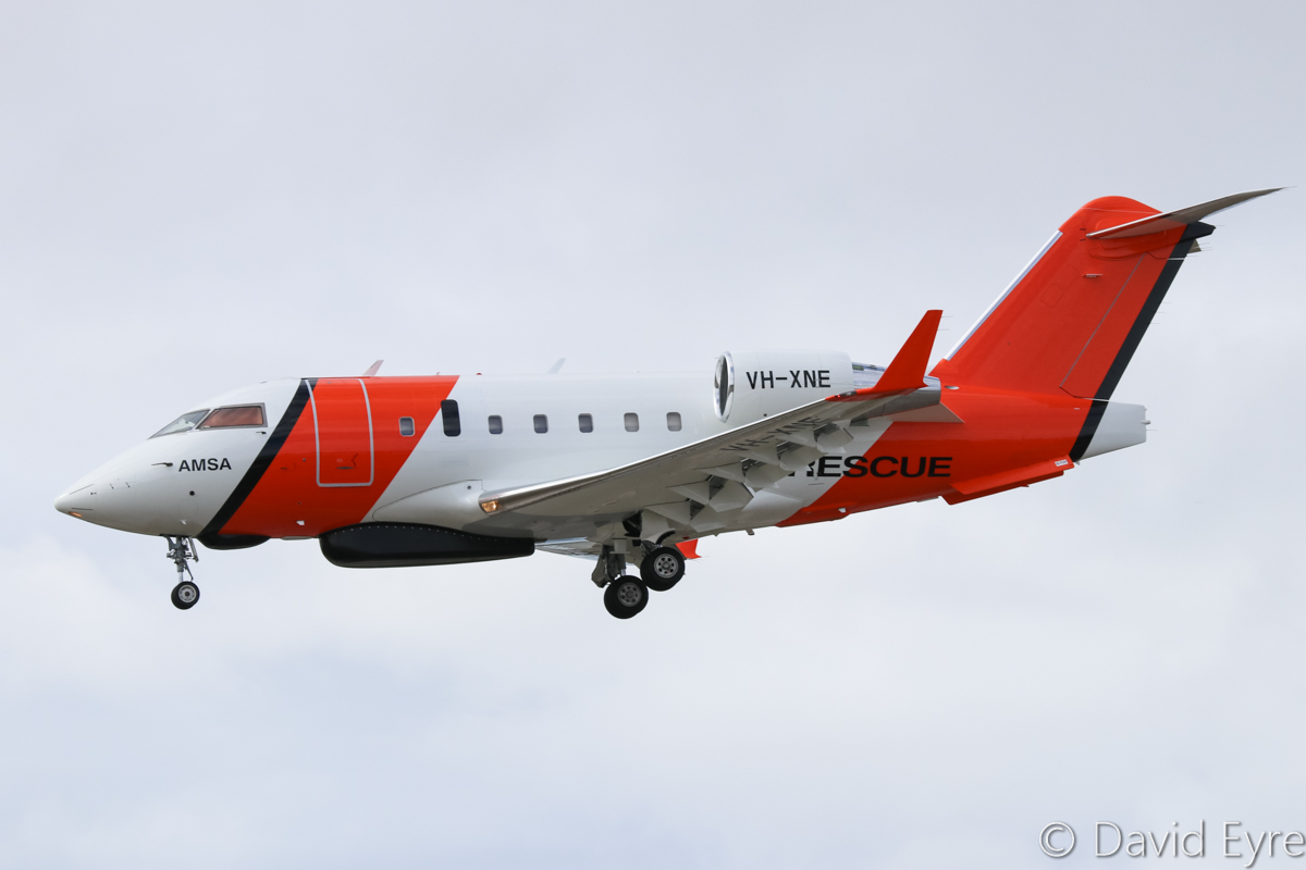 VH-XNE Bombardier CL-600-2B16 Challenger 604 (MSN 5647) owned by Cobham SAR Services Pty Ltd, operated for the Australian Maritime Safety Authority (AMSA), at Perth Airport - Sat 11 February 2017. ** First visit to Perth ** Arriving from Cairns on runway 06 at 9:34am. Used for search and rescue. The long radome under the forward fuselage is a multi mode search radar, whilst the smaller fairing just in front of it contains a search and rescue direction finder. It will also soon be fitted with an electro-optical turret just behind the main wheel bays. Built in 2006, ex C-FMUS, N337FX, C-GLXF. Photo © David Eyre