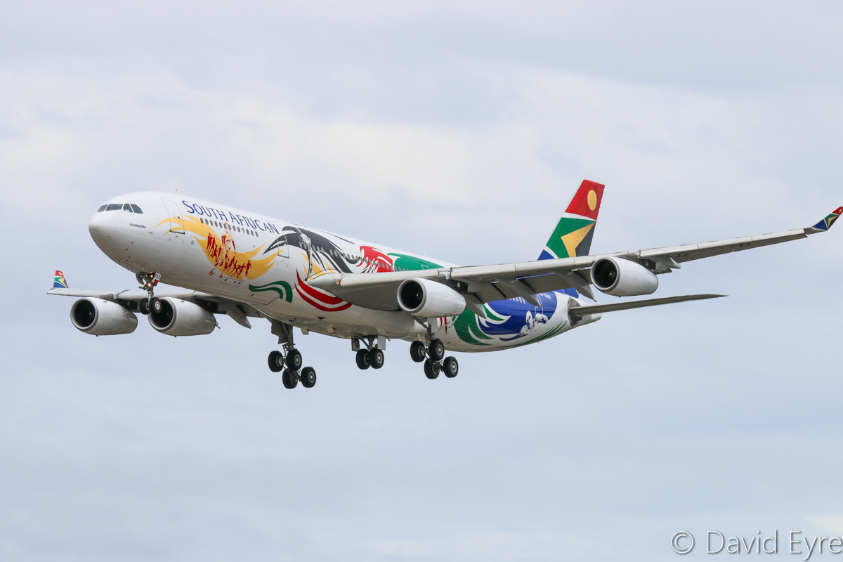 ZS-SXD Airbus A340-313X (MSN 643) South African Airways, in special 2012 Olympics colours, named 'Siyanqoba' at Perth Airport – Sat 11 February 2017. Flight SA280 from Johannesburg, landing on runway 06 at 12:30pm. This was ZS-SXD's first revenue service since 30 October 2016, so it may have been undergoing an extensive overhaul. Photo © David Eyre
